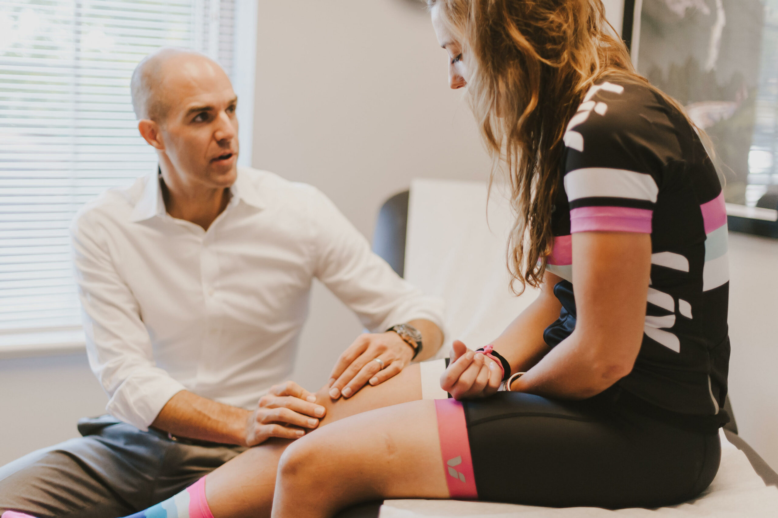 Doctor talking with athlete